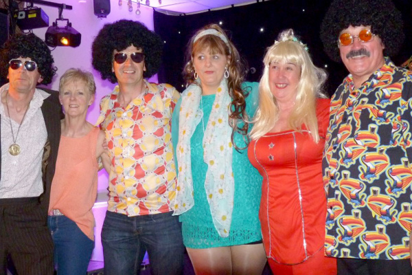 Members dressed for ABBA Tribute Night